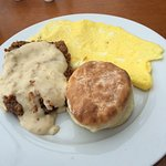 Chicken fried steak and flat eggs with biscuit (to scale).