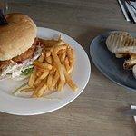 Chicken burger and a chorizo breakfast burrito