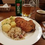 Pork schnitzel with potatoes and fried cabbage