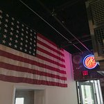 A view from near the bar and exit, and a beautiful USA flag.
