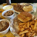 Pulled pork sandwiches, fries, baked beans and potato salad.