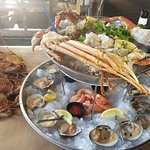 Cold Seafood Platter (~$60) on right; half dozen crabs on left.