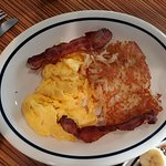 scrambled eggs, hash browns and bacon
