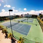 4 Tennis Courts (with lights) in Rebound Ace (Australian Open Surface).