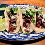 Carne Asada Tacos / Open flame grilled skirt steak  tacos served with lime and salsa verde