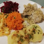 """Typical daily set composed by meat (or fish, as in this case), smashed potatoes, and """"zestaw surowek"""" (set of raw salads)"""