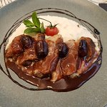 Duck with wine sauce and cheese polenta