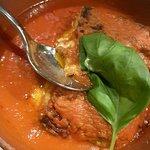 Lasagne alla Bolognese are served in a rich tomato sauce.