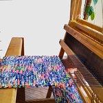 Hand weaving of a fabric for summer handbags.