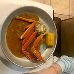 Half pound of crab legs with medium garlic sauce, corn and potato cooked in the sauce.