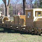 Kids can also enjoy playing on the new wooden train set by the picnic area.