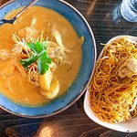 Massaman Curry with chicken and fried noodles.