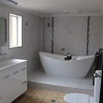 The Deluxe King Suite includes a luxurious bath tub for the ultimate relation