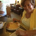 One of our favourite regulars, Sandee, enjoying her morning paper and pancakes ... a la Minnie Mouse..
