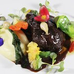 KOKOTXA: Slow Cooked Acorn Fed Pork Cheek with Puree of Parsnip, Brussels Sprouts, Confit of Mini Turnip