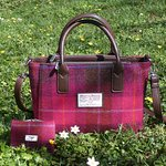 We stock lovely Harris Tweed items in our shops.