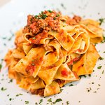 Pappardelle Bolognese Tomato meat sauce.