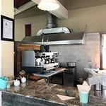 the open kitchen (has a serious coffee maker)