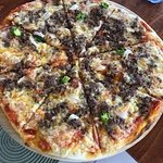 A tasty piping hot beef pizza which was to die for! (There are vegetarian options too)
