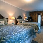 A2 - The Clear View Room Ground floor room with 2 queen beds, desk with chair and gentleman's chest. This room shares a covered porch with 1 other room and has a view of the property. Pet friendly.