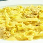 Handmade pasta with fresh salmon