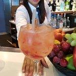 Dahiana makes an artistic gin & tonic!  Strawberry and cinnamon.