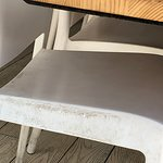 Ingrained dirt on all white plastic chairs, front & back