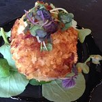 One of a Trio of Crab Cakes Dipped in Japanese Style Bread Crumbs Seared and then Baked with Sweet Chili Wasabi.