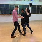 Our Teacher works on some salsa with his couple in a private lesson.