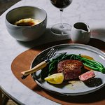 Eye fillet, pasture fed, mustard greens served with a side of smoked mash potatoes.
