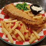Fish and chips with tartar sauce and peas
