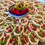 A colourful tray of Falafel Wraps for a party booking.