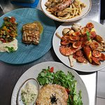 Seafood at it's best - fish fillet, sea delicacies, crabcake, fish stew