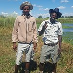 """Jumbo Junction ace guides Monoso and Technic posing in front of """"Hippo Pools,"""" a boat ride away from Jumbo Junction camp on Easter Sunday morning, 21 April 2019."""