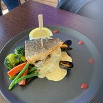 Sea Bass, served with creamy mashed potatoes, seasonal vegetables, served with a seafood sauce