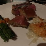 suckling pig with Delmonico potato and asparagus
