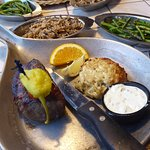"""""""Steak and Cake"""" Steak with a crab cake and 2 sides (I chose the green beans and wild rice."""