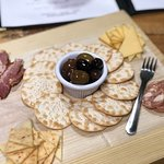 Enjoying cheese, meat, crackers, and olives!