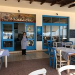 The front of the restaurant with the lady that cooks the most delicious meals
