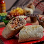 ADOBO CHICKEN; CLASSIC BURRITO FLOUR TORTILLA 12'' Tangy marinated grilled chicken, GREEN RICE, BLACK BEANS, SALSA, SOUR CREAM & CHESSE!