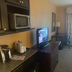 """The counter and """"breakfast"""" or coffee area was fine. A small room size fridge allowed us to keep bottles of water. The TV was very small and showing it's age for today's traveler"""