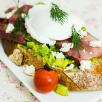 Avocado on toast with bacon and poached egg