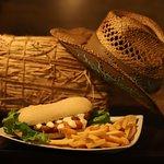 Toro seduto Panino con maxi cotoletta panata homemade  fritta con olio altoleico accompagnato da croccanti patatine