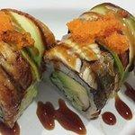 Dragon roll .( 8pics ,krabmeat,avocado & cucumber.eel &avocado on the top.)