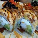 Pear blossom Roll. TOP SELLER. Tempura shrimp.cheese,krabmeat,avocado and special krebmeat on the top.