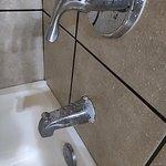 Gross broken shower fixtures that keep dripping