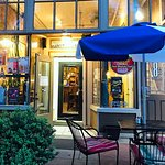Outdoor seating is available along tree-lined cobblestone street