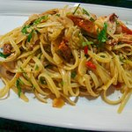 Seafood Aglio Olio - Simplicity at its best! Linguine tossed in olive oil flavoured with chili, garlic and sundried tomatoes with mixed seafood  A vegetarian version of this dish is also available and is vegan friendly