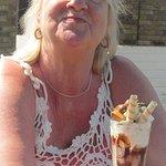 Chocolate and vanilla ice cream topped with cream and piled high with Maltesers®, Cadbury® Crunc