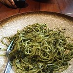 spaghetti pesto with fresh pesto  parmesan and black olives